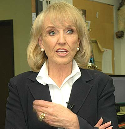 Gov. Jan Brewer is rejecting a plea from county attorneys that she order the state health department to stop issuing cards for people to legally obtain marijuana for medical reasons and not to license dispensaries to sell the drug.