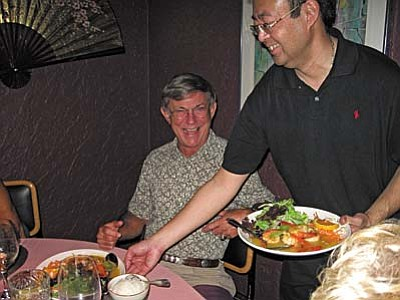 Rick Brothers is anticipating a great meal being served by Tommy at Wild Orchid.