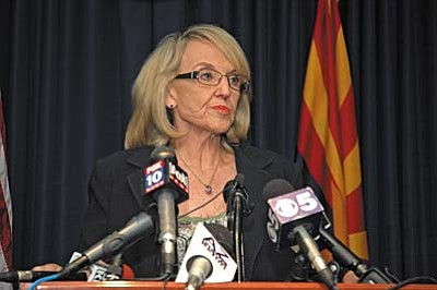 Gov. Jan Brewer reacts Wednesday to the refusal of U.S. District Court Judge Susan Bolton to issue a new injunction against a key provision of SB 1070. (Capitol Media Services photo by Howard Fischer)