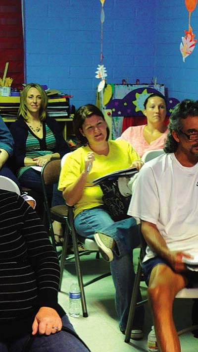Pictured: Misty (center), and the Love and Logic Parenting Class in Cottonwood.