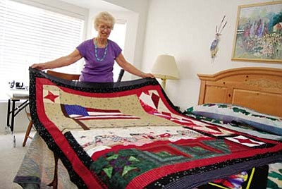 VVN/Steve Ayers<br /><br /><!-- 1upcrlf2 -->After having won every award she says she will ever need, Eunice Hill says her goal now is to give back by making quilts and giving them to charities to help raise money.