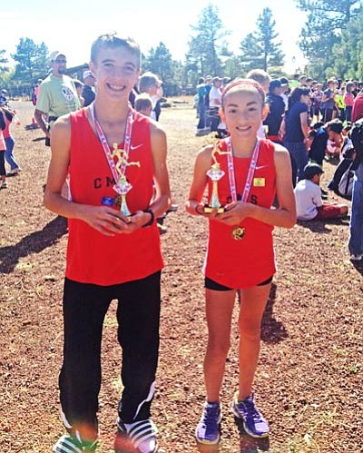 <b>Chris D'Angelo</b> and <b>Allyson Arellano</b> pose for a picture with trophies after a race earlier in the season in Flagstaff. Courtesy Photo