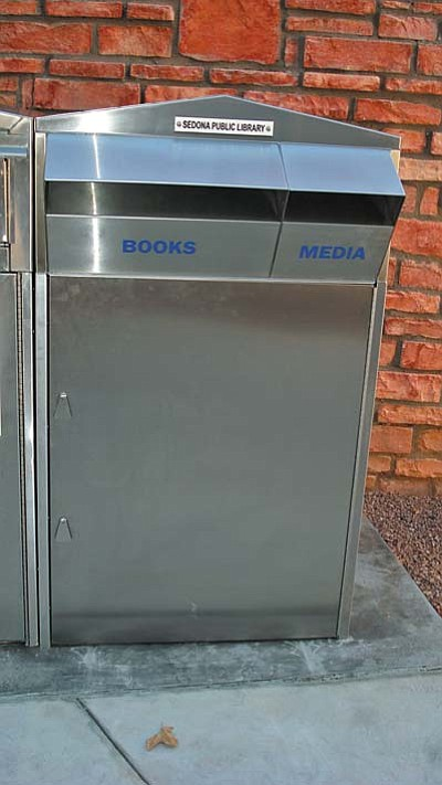 Patrons are encouraged to return library materials to our new and improved drop box when the library is closed.