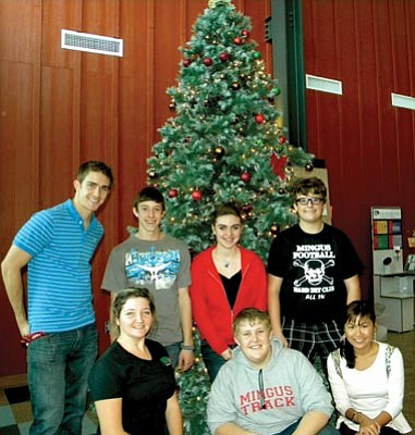 VVN/Jon Hutchinson<br> Dressing the tree Wednesday are CYAC members (top, l-r) Marshall Shill, Robert Valentine, Parker Kleck and Charles Novak. (Bottom, l-r) Adult Advisor Britney Lawler, Shaylor Dowling and Pookie Saengsawang.