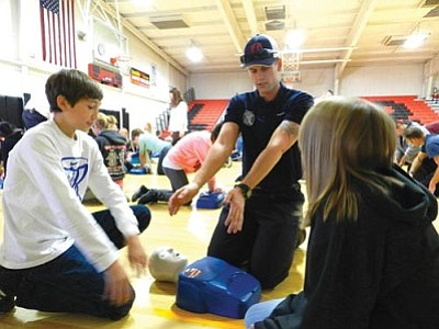 "Courtesy Verde Valley FD<br> Sixth, seventh and eighth grade students in Cottonwood got hands-on training in  ""Chest-Compression-Only"" CPR from Verde Valley Fire District and the Cottonwood Fire Department."