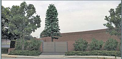 The bogus pine tree that will carry the wireless transmission elements will stand more than five times taller than the surrounding buildings.