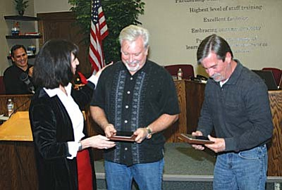 VVN/Philip Wright<br /><br /><!-- 1upcrlf2 -->COCSD Superintendent Barbara U'Ren presented outgoing school board members Randy Garrison and Eric Wyles with a token of appreciation for their service. Garrison served 10 years on the board, and Wyles served 5.