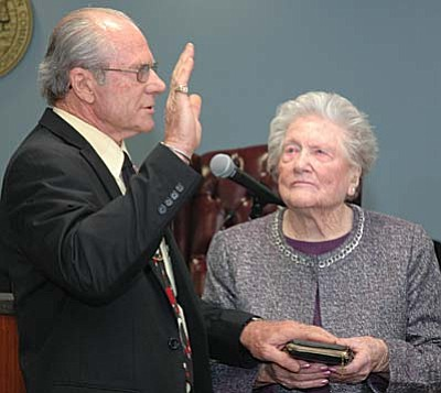 With his 103-year-old mother looking on, Bob Burns, newly elected to the Arizona Corporation Commission, takes the oath of office on Monday. (Capitol Media Services photo by Howard Fischer)