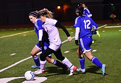<b>Delaney Scanlan</b> fights for position and the control of the ball as she attacks the Bulldogs' defense Tuesday on Bright Field. VVN/Sean Morris