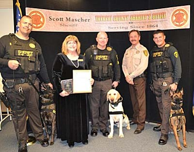 "Courtesy Yavapai County SO<br /><br /><!-- 1upcrlf2 --><br /><br /><!-- 1upcrlf2 -->Standing (l-r) Deputy Jarrod Winfrey with ""Tjando,"" YCCF Co-Chair Sharon Block of Cottonwood, Sgt. Jeff Jaeger with ""Bo,"" Sheriff Mascher, and Deputy Eric Lopez with ""Miley"""