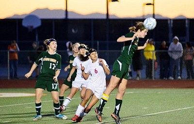 <b>Shannon Costello</b> wins a header to keep the ball away from Mingus freshman striker Martina Bueno in the second half of the Division III girls soccer Championship Friday at Campo Verde HS. VVN/Sean Morris