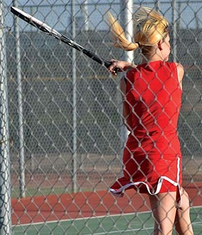 Jenny Kohler returns the serve during a recent tennis match. Kohler dropped her match against Bradshaw, but was the lone Marauder to win against Page. VVN/Travis Guy