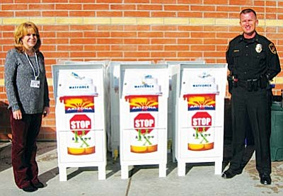 MATFORCE Executive Director Merilee Fowler and Prescott Valley Interim Chief of Police James Edelstein display prescription drug drop boxes that are now available at ten locations throughout the county.