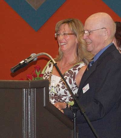 Tim Wiederaenders/Courtesy of The Daily Courier<br> Bonny Smith of Big Park Community School poses for photos, with Yavapai County Education Foundation Board Member Tom Benson, after being named the 2013 Teacher of the Year.