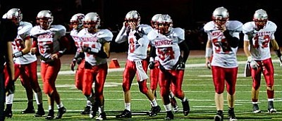 Members of the offense line-up before the snap during Mingus Union's game against Coconino in 2012. VVN/Sean Morris