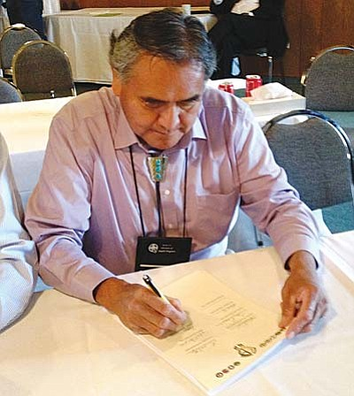 Yavapai-Apache Nation Chairman David Kwail signing historic Apache Alliance charter.