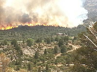 Conrad Jackson, Prescott Fire Department/Courtesy photo<br /><br /><!-- 1upcrlf2 -->A wildfire in Yarnell grew to about 2,000 acres Sunday, claiming an estimated 250 homes and the lives of nearly a score of firefighters.<br /><br /><!-- 1upcrlf2 -->