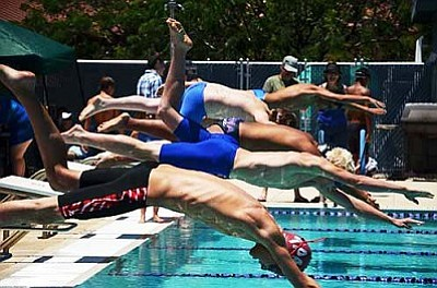 Swimmers from the Cottonwood Clippers and other Northern Arizona swim clubs, dive off the platform at the Sedona Splash. Recently, The Clippers came in fourth at the Dick Tomlin Invitational in Kingman. VVN/Travis Guy