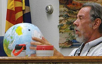 Cottonwood City Council Member Terence Pratt examines a globe used in the city's water conservation education program. VVN/Jon Hutchinson