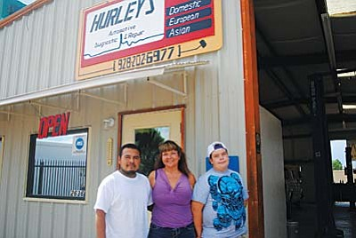 The Hurleys at their recently opened auto repair shop.