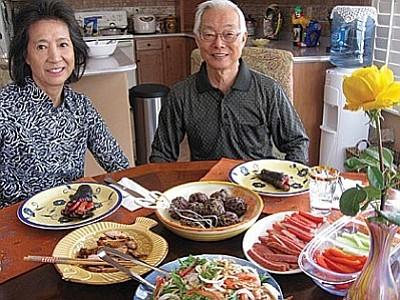 Sue and Bob Tawara sitting before their delicious Korean luncheon<br /><br /><!-- 1upcrlf2 -->