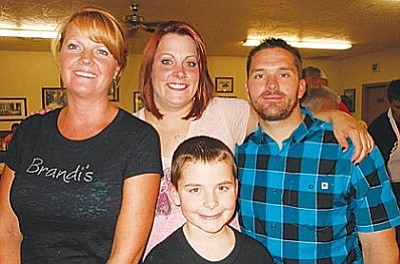 Brandi Fuller of Brandi's Kitchen in Cottonwood, left, sponsored a spaghetti supper for Sgt. Jordan Maynard, wife Jennifer and son Jay. Organizer Pam Van Winkle, President of Post 7400's Ladies Auxiliary, reports that the final tally raised for Homes for Our Troops was a whopping $6,106. Homes for Our Troops is building an accessible home in the Verde Valley for Sgt. Maynard.
