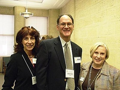 From left, Rose Boerner, Robert Cartia, and Emily Jenkins at the State Capitol, advocating for Medicaid expansion.