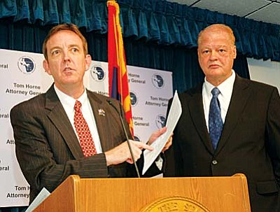 Secretary of State Ken Bennett and Attorney General Tom Horne detail a lawsuit filed Wednesday to force a federal agency to include a requirement on its voter registration forms that applicants provide proof of citizenship. (Capitol Media Services photo by Howard Fischer)