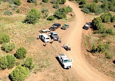 Courtesy Yavapai SO<br> The rescued man safely returns to the search staging area on his ATV.