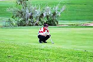 Senior Gary Baker eyes a putt. VVN/Travis Guy