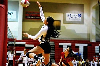 Senior Angel Chavez nails a kill during a match. Chavez is one of the Marauders' two captains on the team. VVN/Travis Guy