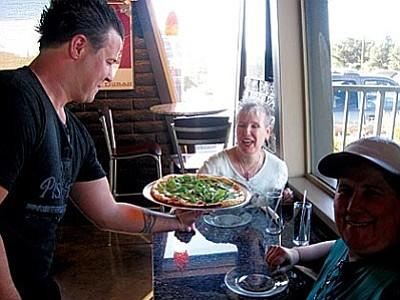 Owners of newly opened Stargate Productions, right around the corner from Pisa Lisa's. Marie Captain and Lisa Jordan enjoy meatless Pizza Blanca.