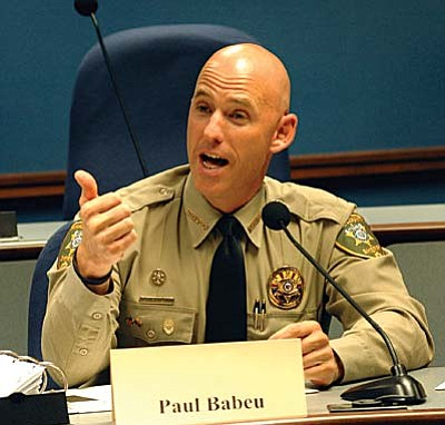Pinal County Sheriff Paul Babeu lashes out Wednesday at Congress and federal immigration officials for failing to secure the border while discussing an immigration reform proposal. Babeu told a legislative committee the border could be secured if there were the political will to do it.  (Capitol Media Services photo by Howard Fischer)
