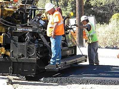 Alliance Street Works, contracted to re-build 10th street in Cottonwood, poured the black ribbon of asphalt between the new curbs, sidewalks and gutter Wednesday.  VVN/Jon Hutchinson