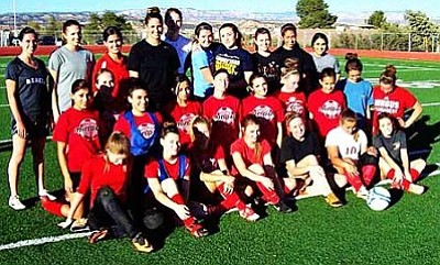 Members of past and present Mingus girls' soccer teams pose for a picture after the Alumni game. Photo courtesy of Doug Braly