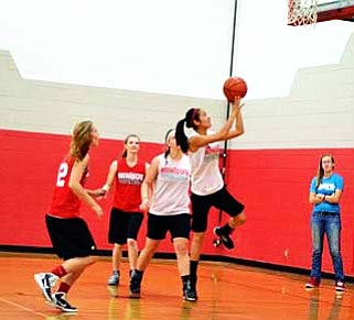 Senior Monica Soliz goes up for a lay-up while drilling plays in practice. VVN/Travis Guy