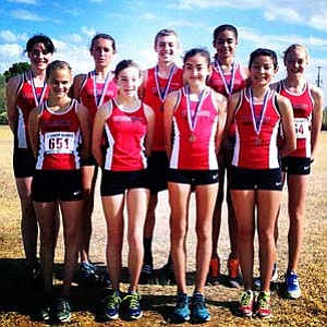 The Aftershock Distance Club poses with their hardware following the USATF Junior Olympic Arizona Cross Country State meet. Photo courtesy of Aftershock Distance Club