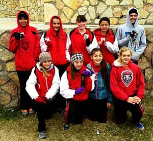 The Aftershock Distance Club poses with their hardware following the USATF cross country regionals. Seven of Aftershocks' nine runners qualified for nationals. Photo Courtesy of Aftershock Distance Club