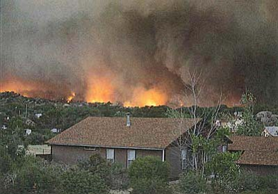 Tom Story/Courtesy photo<br /><br /><!-- 1upcrlf2 -->Fire spreads in Yarnell's Glen Ilah neighborhood June 30.