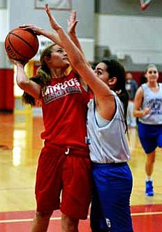 Senior Amber Rippy throws up a shot over a Joy Christian defender during the Marauders scrimmage. VVN/Travis Guy