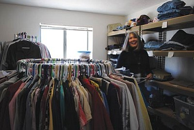 Janet Conchy runs the donation room at Catholic Charities, providing shirts, shoes, pants and jackets to The Loft's visitors.