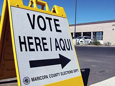 A voting sign outside Maricopa County Recorder's Office early tabulation center during the 2012 general election. (Cronkite News Service Photo by Natasha Khan)