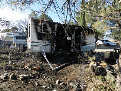 Fire claimed an RV and threatened a mobile home in Cottonwood on Wednesday.