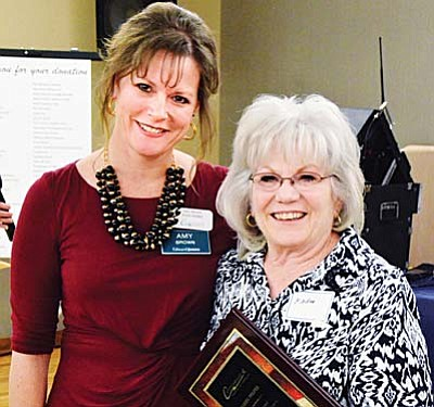 Karen Pfeifer was presented with the award for Volunteer of the Year by incoming board chair Amy Brown.