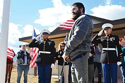 Marine Sgt. Jordan Maynard stands in front of his completed home, surrounded by US Armed Forces Veterans, Marine Corp soldiers and Homes for Our Troops personnel on Saturday in  Cottonwood.