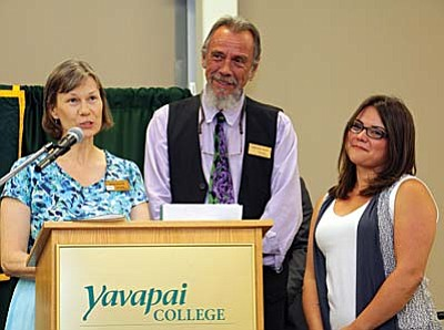 Rebecca McCullough (right), a member of the All-USA Academic Team, received the Vice President's Award for Academic Excellence at Yavapai College's annual Evening of Recognition event April 22 on the Clarkdale campus. Linda Evans, coordinator of Student Support Services and Veterans Upward Bound, and Terence Pratt, English professor, introduced Rebecca at the event.