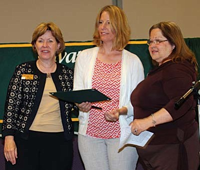 Sarah Little (center) was honored as Yavapai College's Outstanding Student in Nursing at the college's annual Evening of Recognition event on the Clarkdale campus April 22. Nursing instructor Sandy Johnson (right) presented the award along with Yavapai College President Dr. Penny Wills.