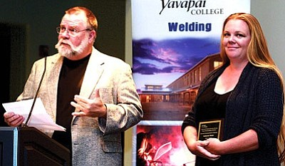 Katy Welch, pictured with instructor Rick Peters, received the President's Award.