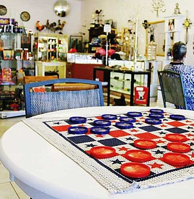 Crystal Lattice has filled some of the additional square footage of its new location with tables for its customers to play a game of checkers or chess. VVN/Bill Helm<br /><br /><!-- 1upcrlf2 -->
