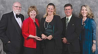 From left, VVREO Directors accepting the EDDE award: Tom Pitts, Co-Chair, Yavapai County Sector Strategy Team; Penny Wills, President, Yavapai Community College; Mary Chicoine, VVREO Chair; Casey Rooney, Economic Development Director, Cottonwood; and, Jodie Filardo, Economic Development Director, Clarkdale.